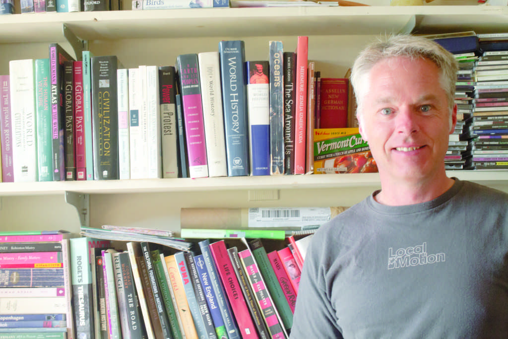 Frank Zelko discusses his work in environmental activism and environmental history in his office Sept. 16. Originally from Australia, he began teaching in Vermont in 2007. TIANA CRISPIN/The Vermont Cynic