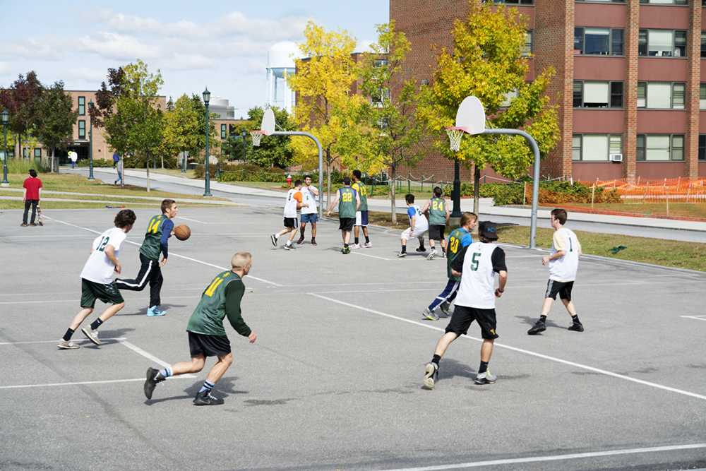 Students play pickup basketball outside of Harris Millis residential hall Oct. 2. UVM researchers are researching methods of decreasing suicide rates, including increased exercise.  KAT WAKS/ The Veromont Cynic
