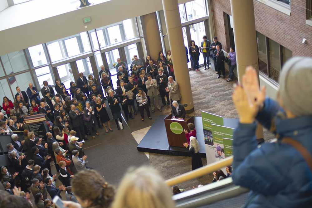 Crowds fill the Davis Center to listen to the UVM Foundation's fundraising announcement Oct. 2. President Sullivan is at the podium. OLIVER POMAZI/The Vermont Cynic