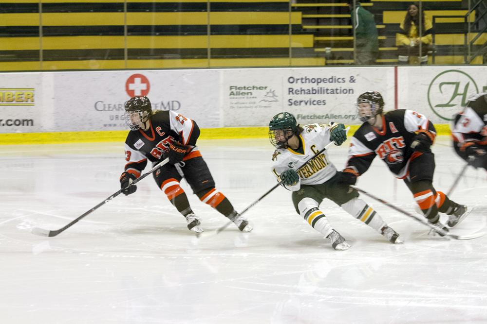 (Top left) Junior Casey Leveillee lines up for a face off at Gutterson Fieldhouse Sept. 27 against McGill University. (Top right) Amanda Pelkey skates on the ice at Gutterson Fieldhouse Oct. 18 against RIT. DAYNA WYCKOFF/The Vermont Cynic