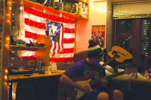 First-year David Bryant plays guitar in the Patterson Hall Wellness Environment April 8.