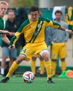 Senior Gideon Rosenthal battles for the ball during a game against Dartmouth College Oct. 1, 2014. (Photo: Brian Jenkin)